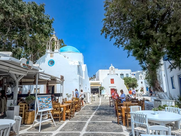 Cafes and an old domed church in the Little Venice neighborhood on Mykonos