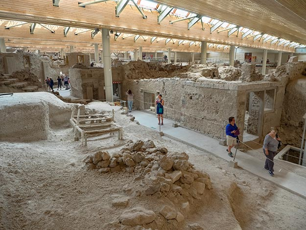 "Excavations at the ancient city of Akrotiri on the island of Santorini turned up ""hollows"" in the ash that were wooden beds set outside the houses, presumably because of earthquakes"