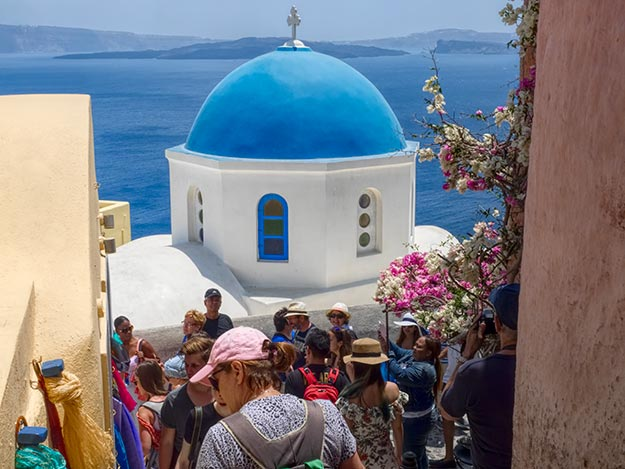 Crowds clog stairway in the town of Oia on the Greek island of Santorini