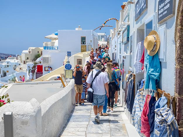 Everyone who visits the Greek island of Santorini makes a beeline for Oia, a village located on the northern caldera rim famous for its whitewashed houses and blue domes. On most days, that means shoulder-to-shoulder crowds on the main street.