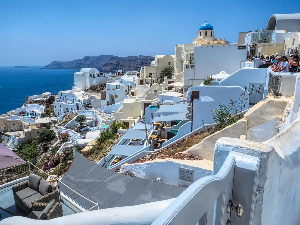 The photo that every visitor to Santorini wants to capture, the blue domes and whitewashed houses in the village of Oia, Santorini