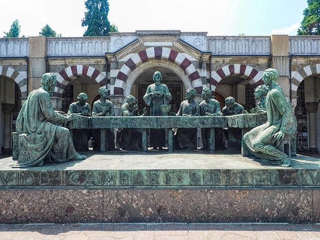 Bronze sculpture of the Last Supper by Giannino Castiglioni sits in front of the Campari family tomb in Monumental Cemetery in Milan, Italy