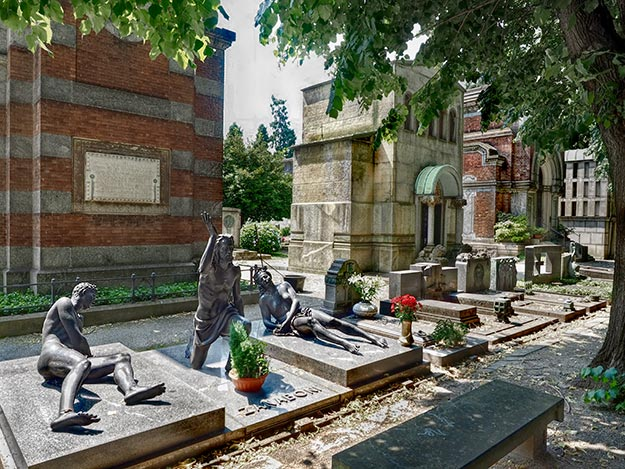 Statues of passion and anguish at Milan's Cimitario Monumentale (Monumental Cemetery)