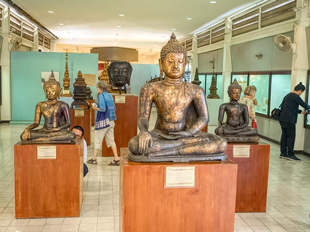 Sculptures and artifacts displayed at the Hariphunchai National Museum in Lamphun