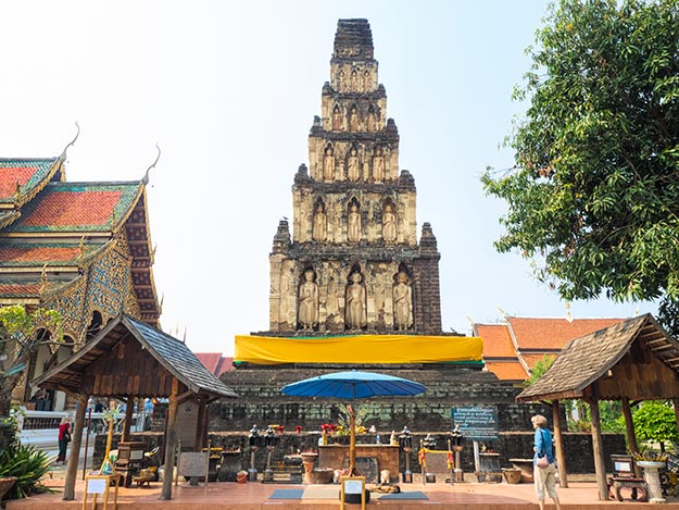 Wat Cham Thewi in Lamphun, Thailand, one of the most important sites from the era of the Hariphunchai Kingdom, with viharn (worship hall) at left and Ku Kut Chedi in center