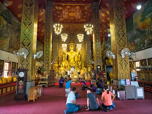 Interior of Wat Phra That Hariphunchai features the Phra Chao Thongtip, a highly revered large seated Buddha cast in the Lanna style during the late 15th century