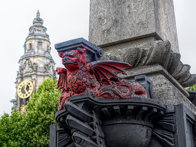 Red dragon sculpture squats at the base of an obelisk in the center of Cardiff