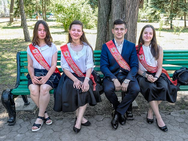 High school graduates in a park in central Chisinau chat with me about their plans for the future