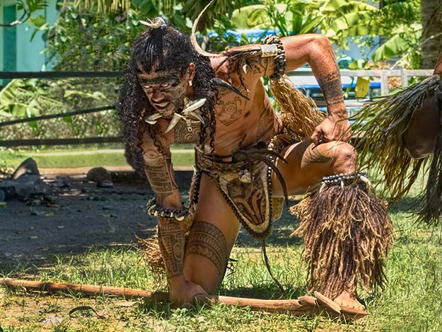 Marquesan warrior performs the terrifying Haku dance on the Marquesan island of Ua Pou during my French Polynesia cruise