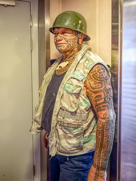 Seaman aboard the Aranui 5 cruise ship is covered from head to toe in tattoos