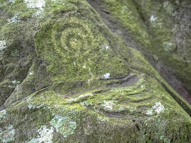 Spiral or rainbow petroglyph carved into a boulder on Nuku Hiva Island represented the eye of the ancestor