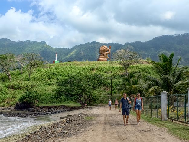 Giant Tiki sculpture gazes out to sea from a hilltop on the island of Nuku Hiva in the Marquesas Islands of French Polynesia