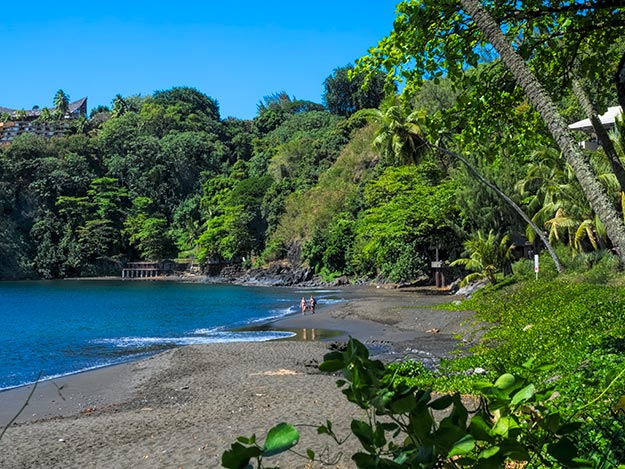 At Tahiti Pearl Beach Resort, the black sand of Lafayette Beach sparkles like a billion tiny diamonds