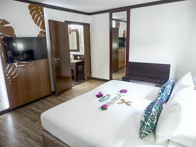 Spacious bedroom in my deluxe ocean view suite at Tahiti Pearl Beach Resort