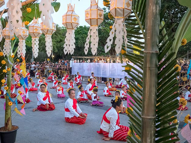 Thai dancers listen to the monk's blessing in the center of the Old City before the festivities commence