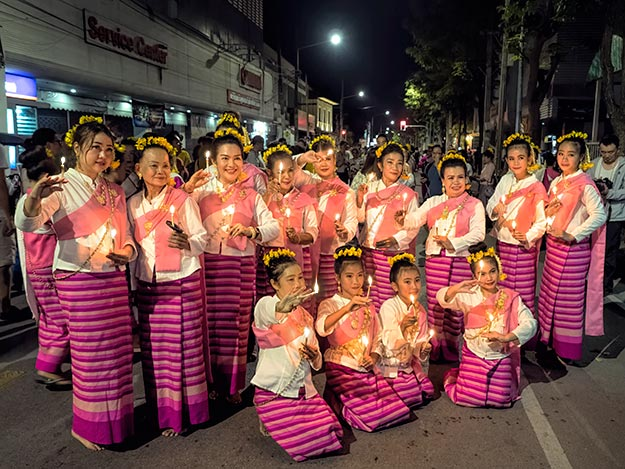 One of the dance groups poses for photos after performing during the opening ceremonies of Loy Krathong Festival