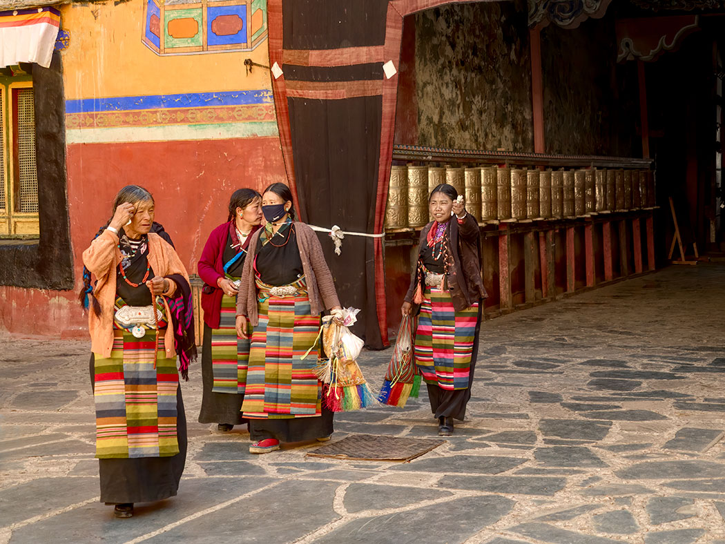 Women in traditional Tibetan clothing at Sakya Monastery in Tibet