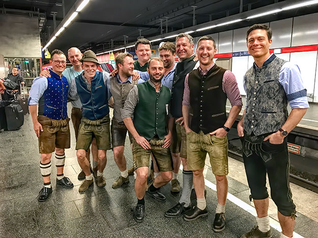 Munchner men on the way to a local festival wear traditional Lederhosen garb