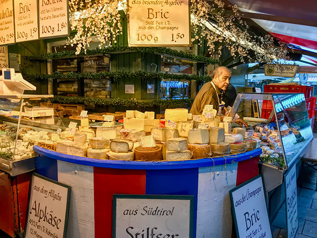 Cheese and wine kiosk at Viktualienmarkt open air market in the center of Munich