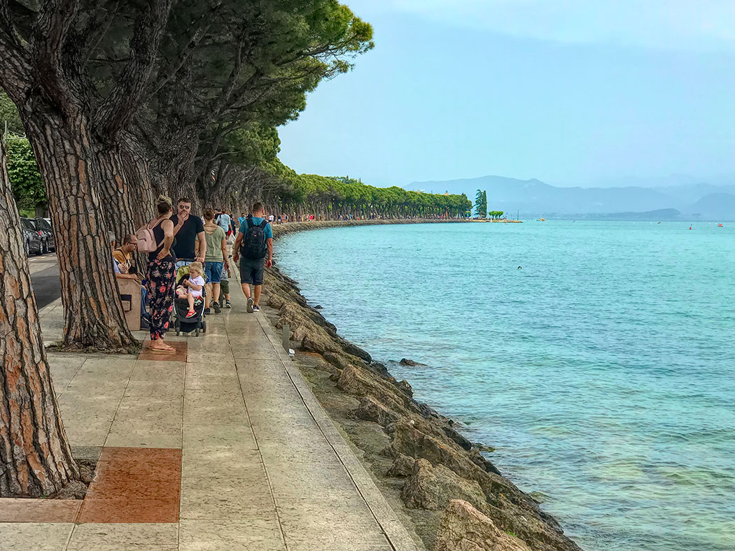 Strolling along the shores of Lake Garda in Peschiera del Garda in the Lakes District of Italy