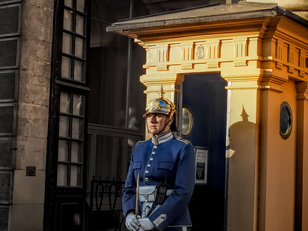 Member of the Swedish Royal Guards stands at the entrance to the Royal Palace in Stockholm, Sweden