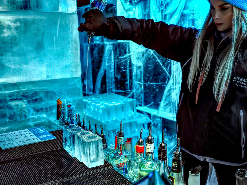 Bartender pours an icy drink at the Stockholm ICEBAR