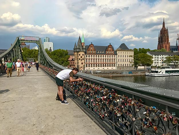 Pedestrian Iron Bridge over the River Main is covered with love locks