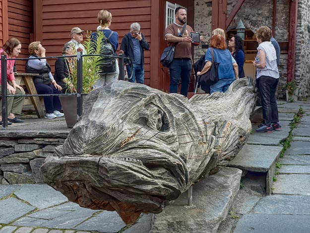 Giant wooden carving of a codfish in Bryggen symbolizes the importance of the fish to the development of Bergen