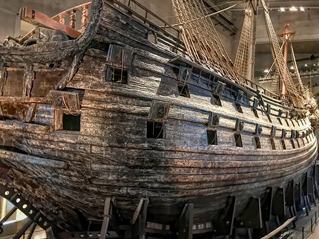 The hull of the Vasa warship today, with its cannon doors propped open