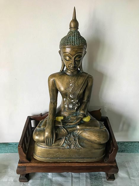 My bronze Buddha on my home altar, after the blessing ceremony