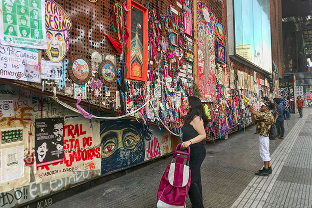 Street art focusing on the protests cover the exterior walls of Centro Gabriela Mistral Cultural Center