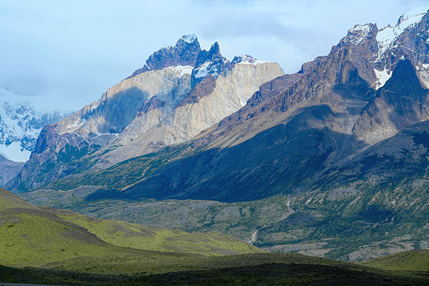 Multicolor Cordillera de Paine shows sedimentary banding perched atop volcanic granite