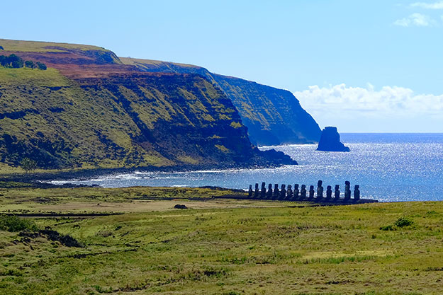 The most famous Moai of Easter Island, standing on the platform at Tongariki, seen from Rano Raraku quarry