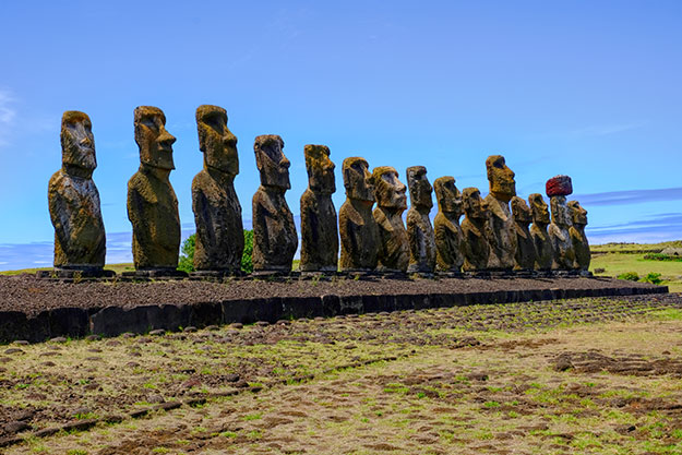 Fifteen Moai standing on an ahu at Tongariki, the most famous Moai platform of Easter Island