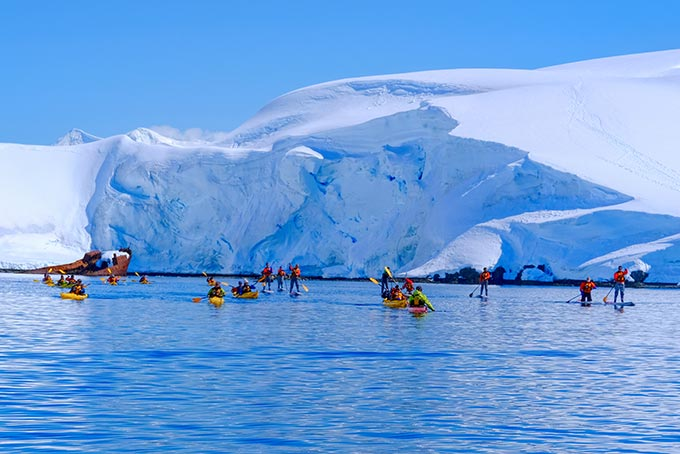 Paddle boarders and kayakers in Wilhelmina Bay