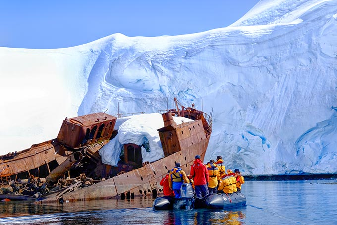 From the comfort of our Zodiac, we explore the wreck of an old whaling ship in Wilhelmina Bay