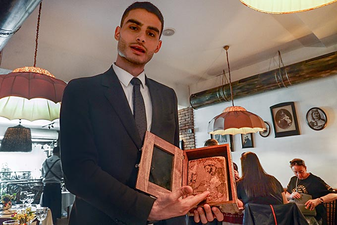 Manager at Restaurant Barbarestan shows me the book of Georgian recipes, written in 1874, upon which the menu of the restaurant is based