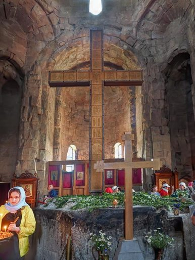 Remnants of the original wooden cross brought to Jvari Monastery in Mtskheta Georgia are entombed in the octagonal base where the modern cross now stands