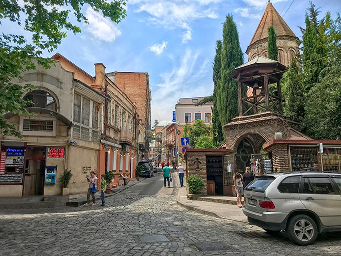 One of the few authentic things to do in Tbilisi is to walk the narrow stone-paved streets above Old Town, here shown with Jvaris Mama Church tower at right
