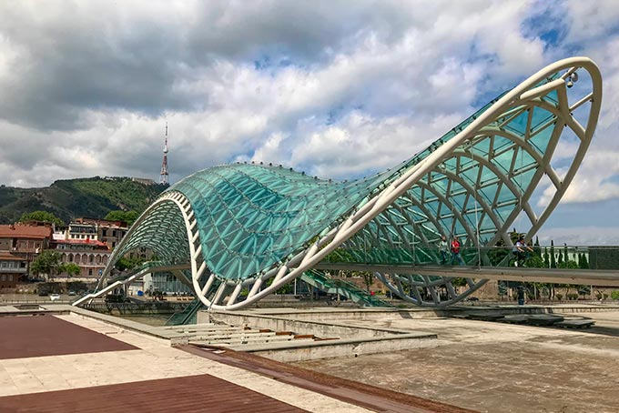 The glass and tubular steel Peace Bridge connects Tbilisi's Old Town with Rike Park