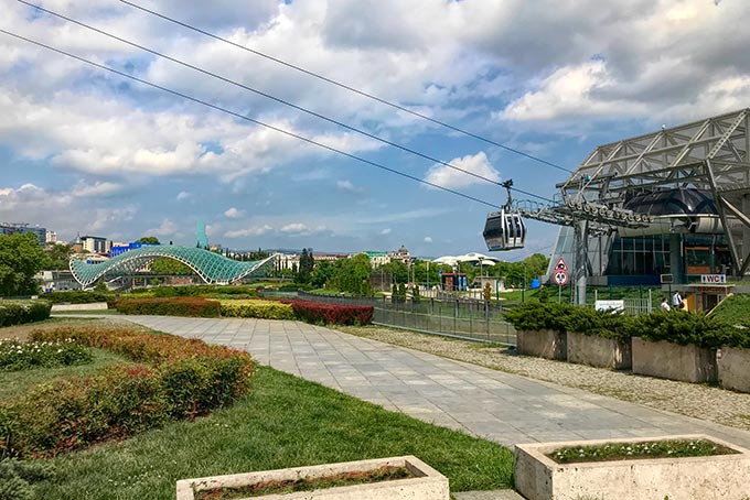 Rike Park cable car to the hilltop Narikala Fortress, with Peace Bridge in the background