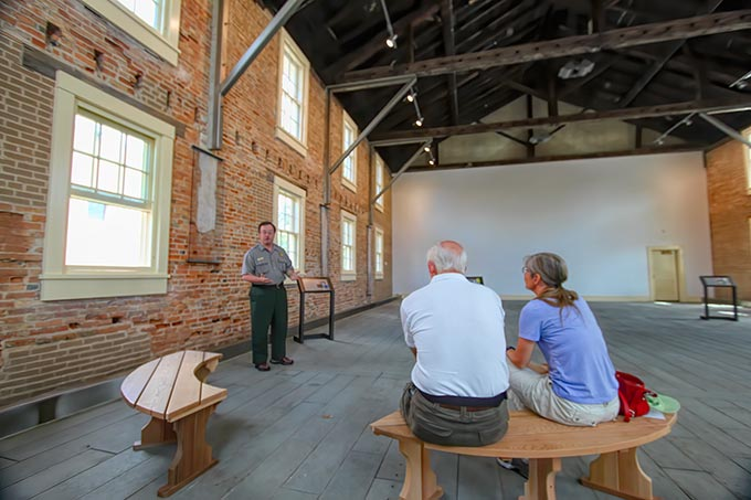 Park Ranger presentation on the history of the women's suffrage movement, inside the restored Wesleyan Chapel