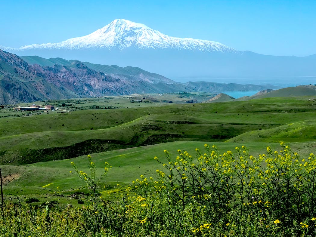Lush greenery of the Armenian countryside, with Mt. Ararat on the horizon