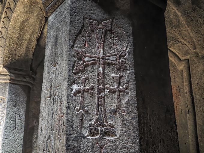 Visiting Armenian crosses carved into Geghard Cave Monastery were believed to have the power to save a soul