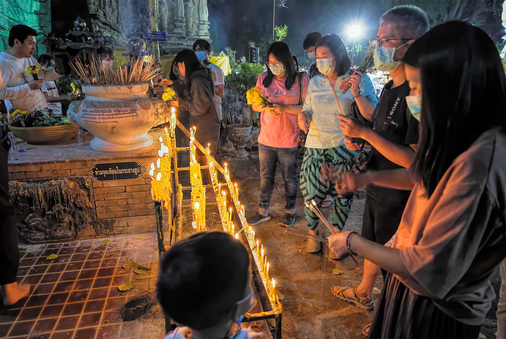 Worshipers light candles at Wat Jed Yod in Chiang Mai, Thailand, to pay respect to Buddha during Makha Bucha Day