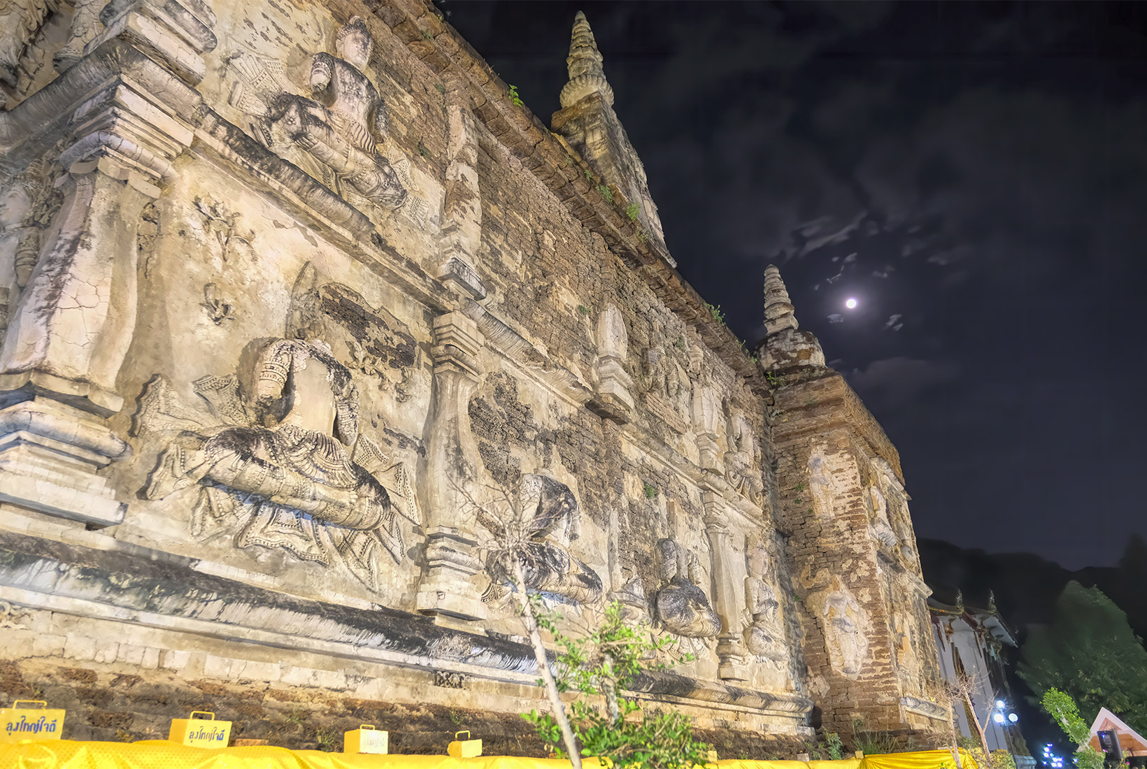 Moonrise over the 800-year old Viharn at Wat Jed Yod during the Makha Bucha Day festivities