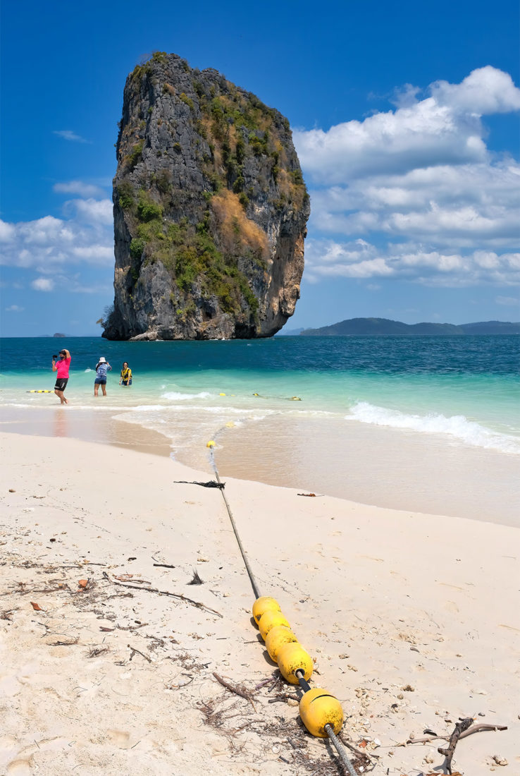 One of the most famous views in southern Thailand, the towering limestone stack offshore from Poda Island