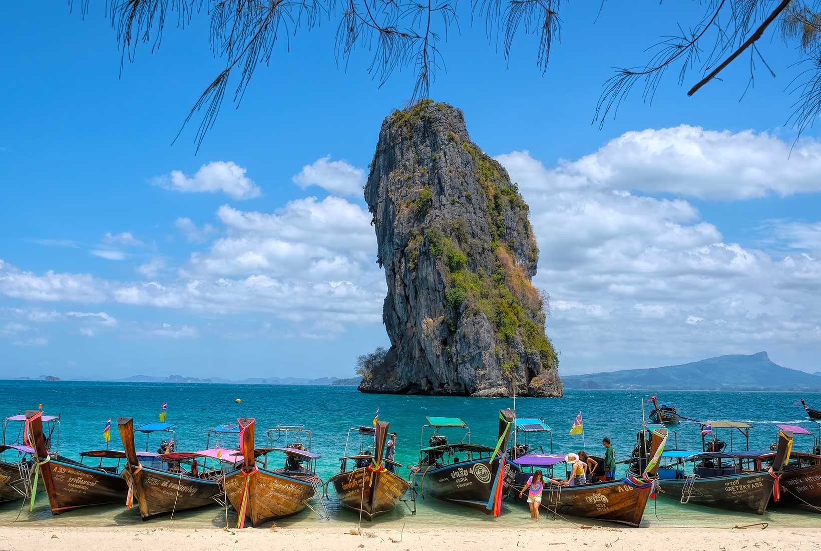 Colorful line of longtail boats on the beach at Koh Poda