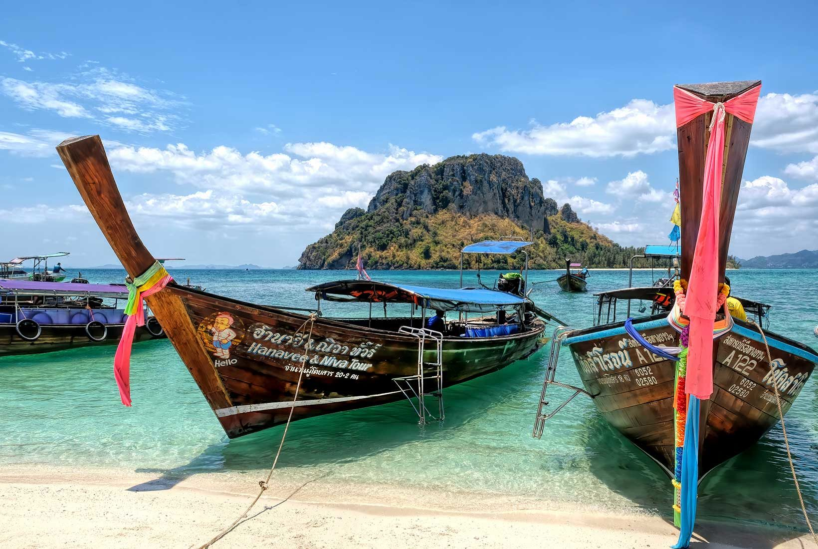 Longtail boats at Koh Tub, a tiny speck of an island in Krabi Province in southern Thailand