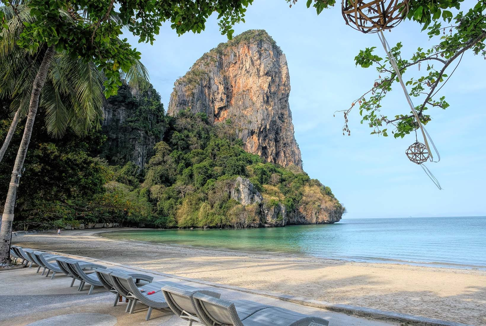 Karst limestone formations bracket both ends of lovely Railay Beach West